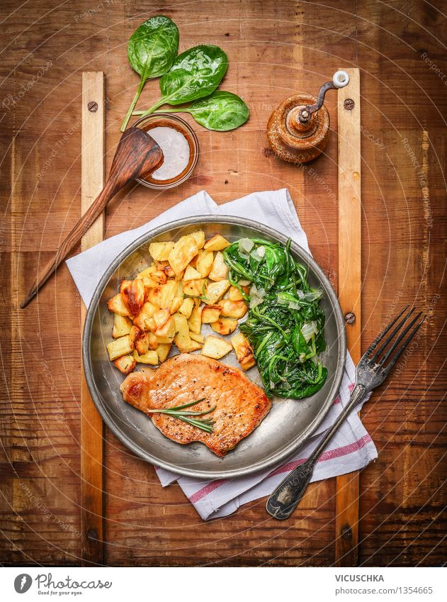 Rustic food - Pork steak with potatoes and spinach Food Meat Vegetable Lettuce Salad Nutrition Lunch Dinner Organic produce Plate Bowl Cutlery Fork Spoon Style