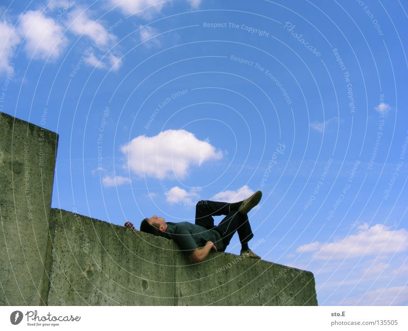 Human being Man Youth (Young adults) Old Sky Summer Calm Clouds Loneliness Relaxation Wall (building) Stone Wall (barrier) Masculine Concrete