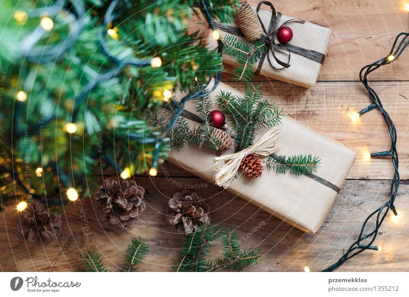 Christmas presents under a tree Tree Paper Package Box Wood Tradition Guest December Story Gift Home Horizontal Pine Rustic Seasons Wrap Colour photo