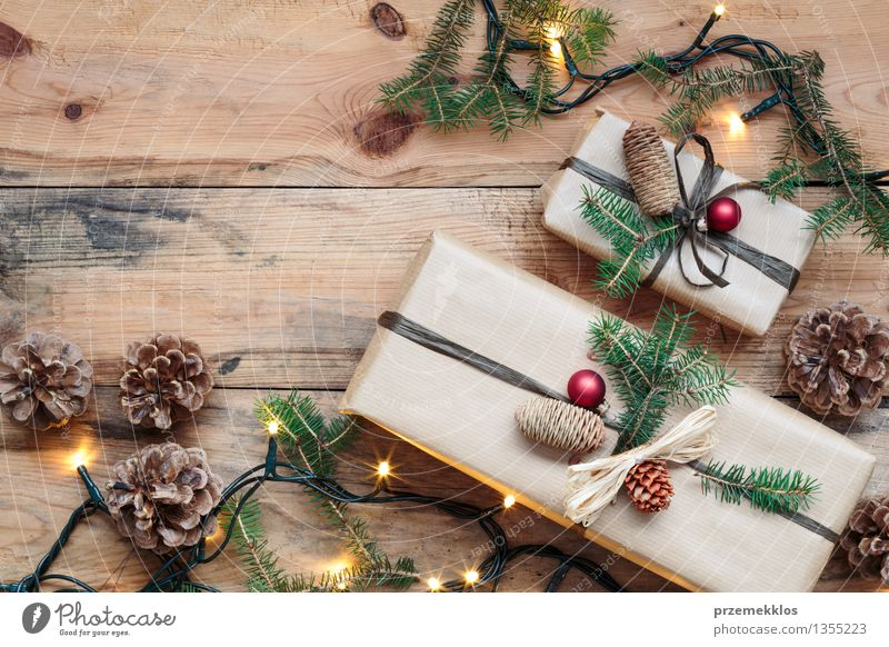 Wrapped Christmas presents on wooden floor Paper Package Box Wood Tradition Guest December Story Gift Home Horizontal Pine Rustic Seasons Colour photo