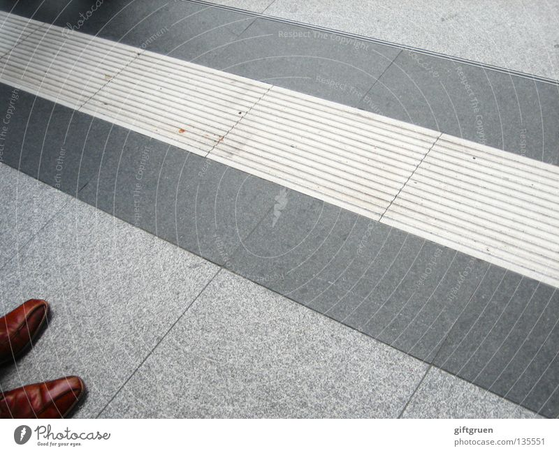 Man Footwear Business Wait Clothing Stand Floor covering Stripe Airport Train station Boredom