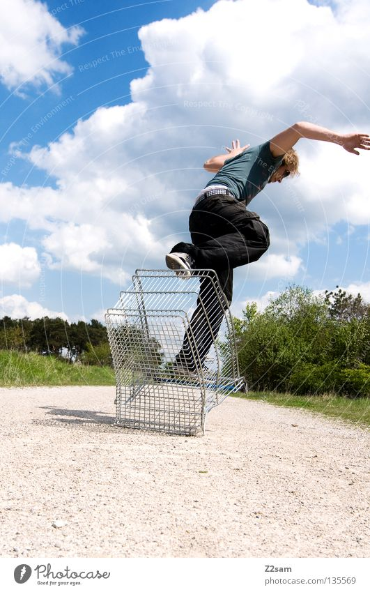shopping surfer - take off Clouds Stand Contentment Shopping Trolley Cage Meadow Green Summer Juicy Physics Summery Man Masculine Action Dangerous Blonde