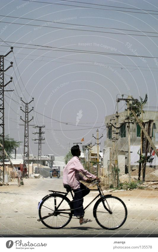 cruising Bicycle Cycling Past Vacation & Travel Tread Pedal Summer Driving Derelict Dry Electricity pylon Sand Rural Physics Hot India Transport cruise