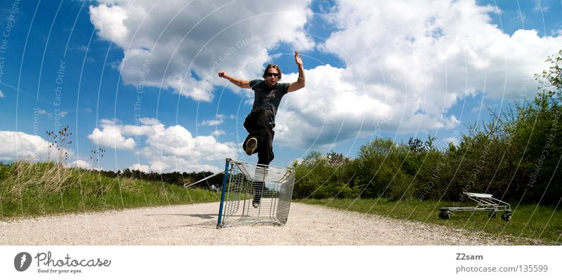 shopping surfer - flight Clouds Stand Contentment Shopping Trolley Cage Meadow Green Summer Juicy Physics Summery Man Masculine Action Dangerous Blonde