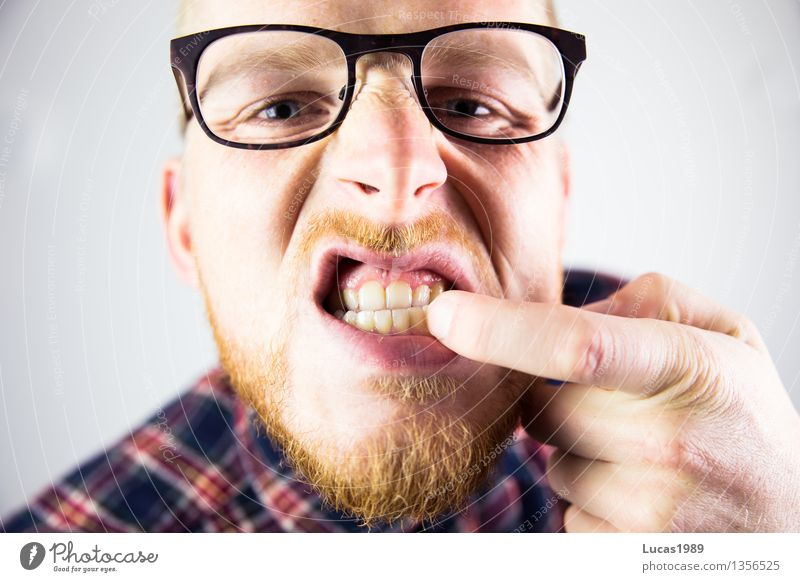 man has something in his teeth Healthy Human being Masculine Young man Youth (Young adults) Man Adults Teeth 1 18 - 30 years Eyeglasses Facial hair Observe