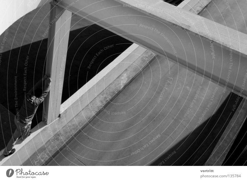 Human being Man White Black Dark Street Above Architecture Wall (barrier) Building Legs Metal Bright Power Arm Concrete