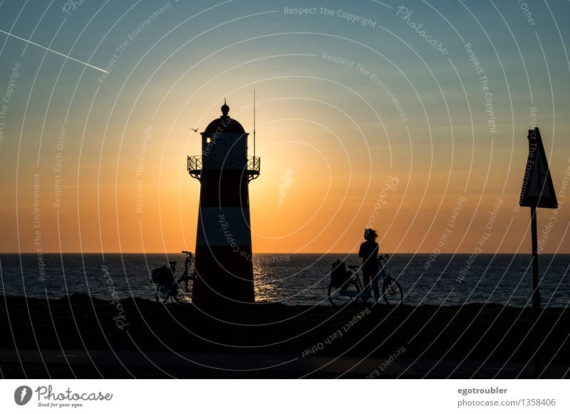 lighthouse Bicycle Vacation & Travel Cycling tour Beach Ocean Woman Adults 1 Human being Water Sky Horizon Sunrise Sunset Autumn Beautiful weather Coast