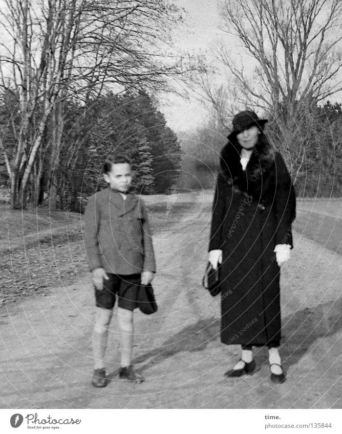 Boy with his mother Boy (child) Woman Adults Mother Beautiful weather Tree Park Clothing Hat Communicate Stand Historic Son Sandy path Shorts Sock Headwear