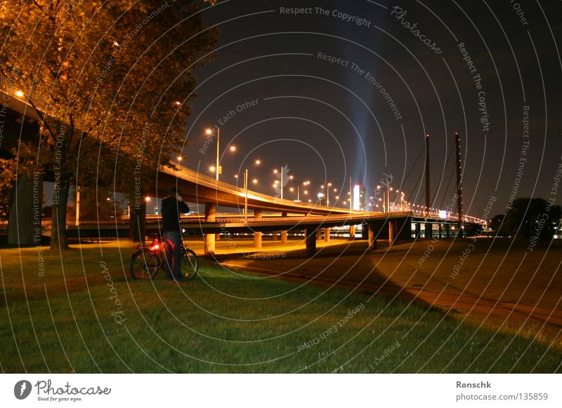 Far away Dark Town Meadow Bicycle Bridge Duesseldorf Rhine lonly