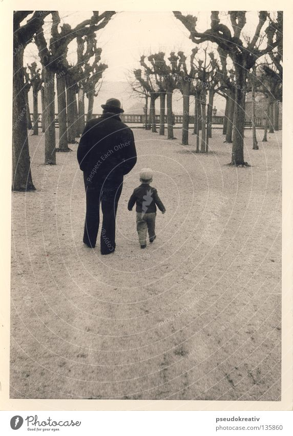 Ewald - a walk in the park Man Son Father Grandchildren Child Black White Direction To go for a walk Tree Park Hiking Going Sandy path Black & white photo