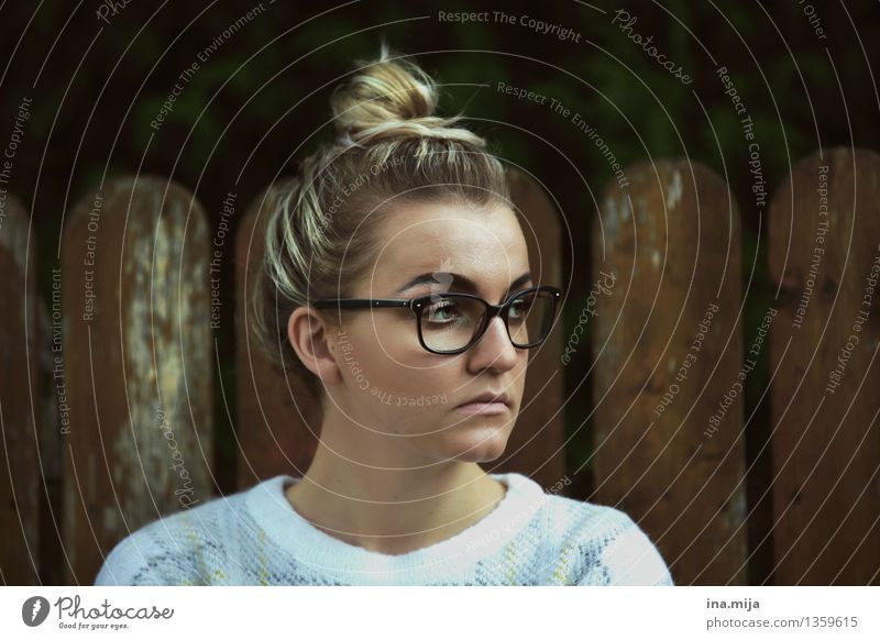 young woman with bun and glasses Human being Feminine Young woman Youth (Young adults) Woman Adults Life Face 1 18 - 30 years Fashion Clothing Accessory