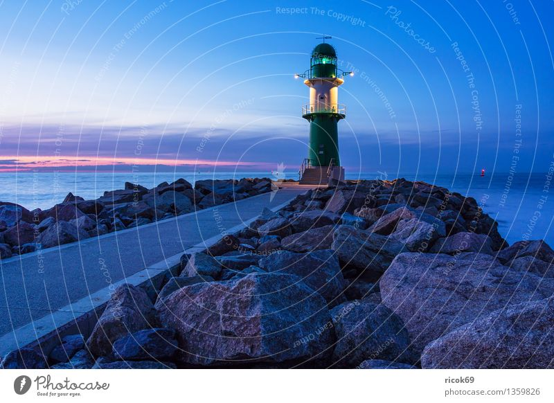 pier light Ocean Nature Landscape Water Clouds Coast Baltic Sea Tower Lighthouse Architecture Tourist Attraction Landmark Lanes & trails Stone Vacation & Travel