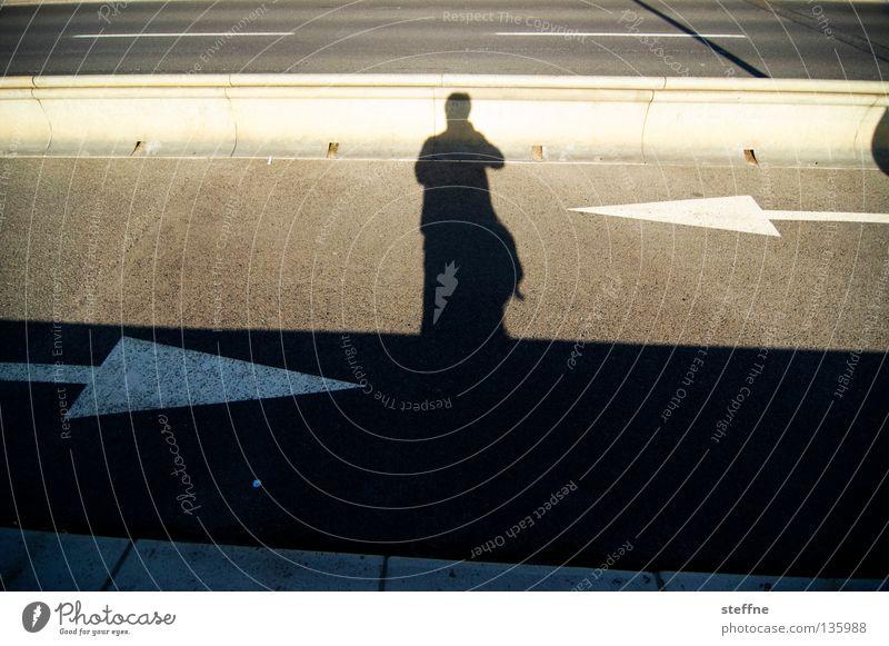 Human being Man Street Floor covering Tracks Arrow Sidewalk Traffic infrastructure Traffic lane Opposite