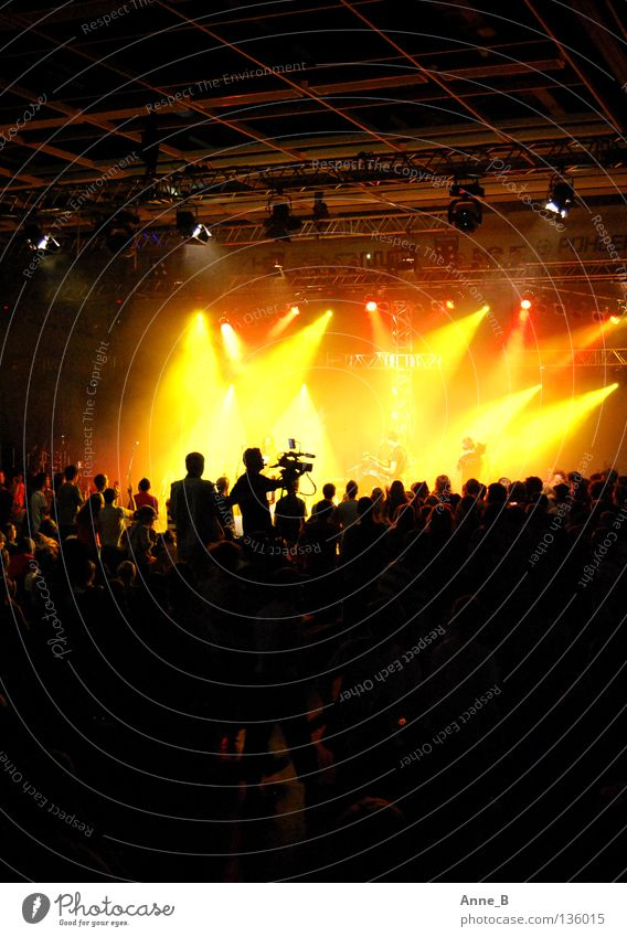 Rocking for Jesus! Party Event Music Audience Crowd of people Stage Concert Yellow Red Black Moody Together Stage lighting Camera-man Loud Rocking out Orange