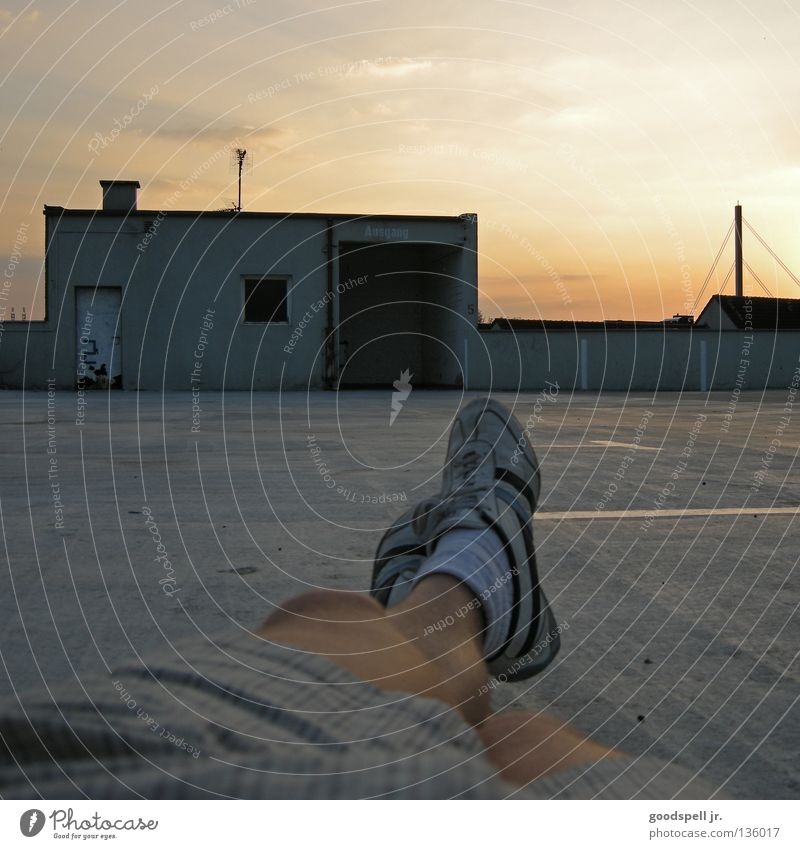 Sky Relaxation Lie Leisure and hobbies Parking lot Sneakers Easygoing Dusk Parking garage Parking level Airy Closing time Goof off First person view Feet up