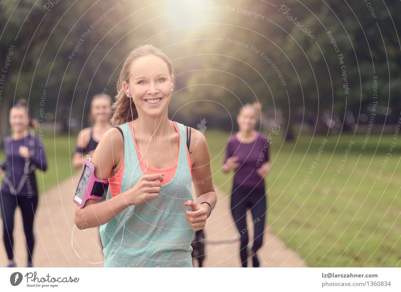 Athletic pretty young woman exercising with friends Woman Dog Summer Relaxation Adults Sports Happy Lifestyle Group Together Friendship Park Action Copy Space Music Arm