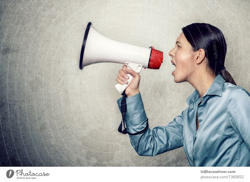 Young woman shouting with megaphone Woman Adults Modern Copy Space Symbols and metaphors Information Shirt Side Conceptual design Loudspeaker Hold Loud Communication Tube Megaphone Silk