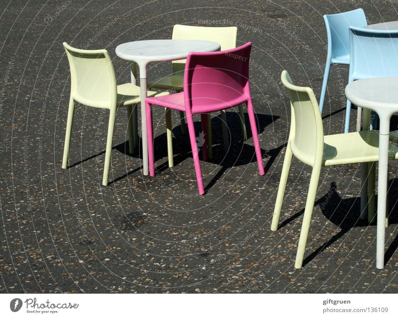 embarras de richesses Selection Chair Empty Loneliness Offset Multicoloured Sidewalk café Café Pink Cyan Yellow Table Summer Asphalt Gastronomy Furniture