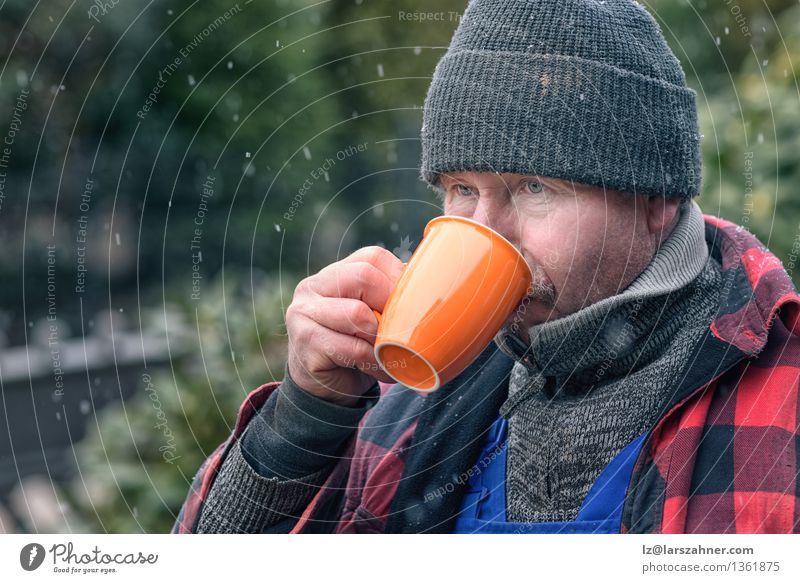 Man in knitted wool beanie drinking coffee Winter Face Adults Warmth Snow Weather Beverage Seasons Drinking Coffee Hot Concentrate Hat Jacket Refreshment