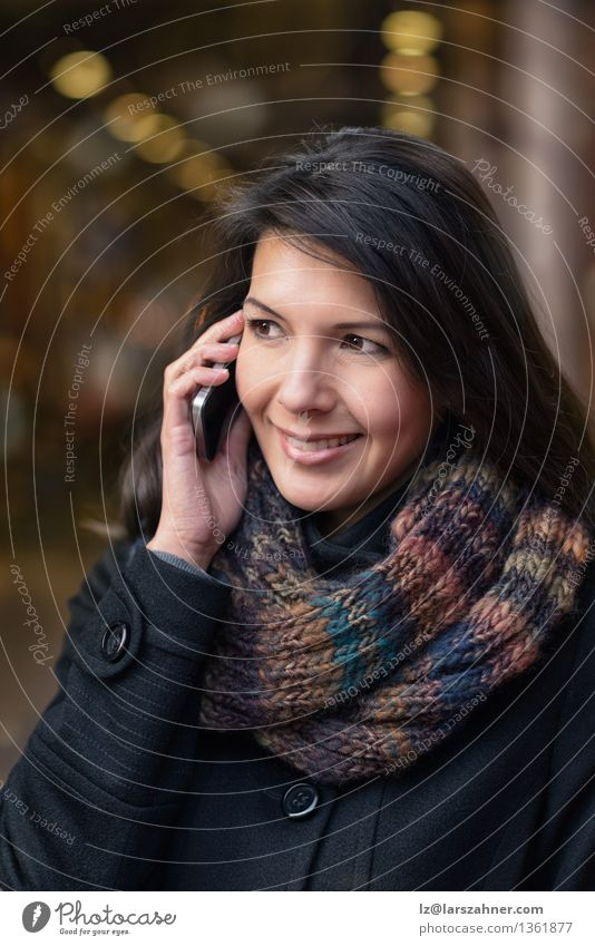 Smiling young woman with phone Lifestyle Happy Beautiful Face Winter To talk Telephone PDA Feminine Woman Adults 1 Human being 30 - 45 years Autumn Town Street