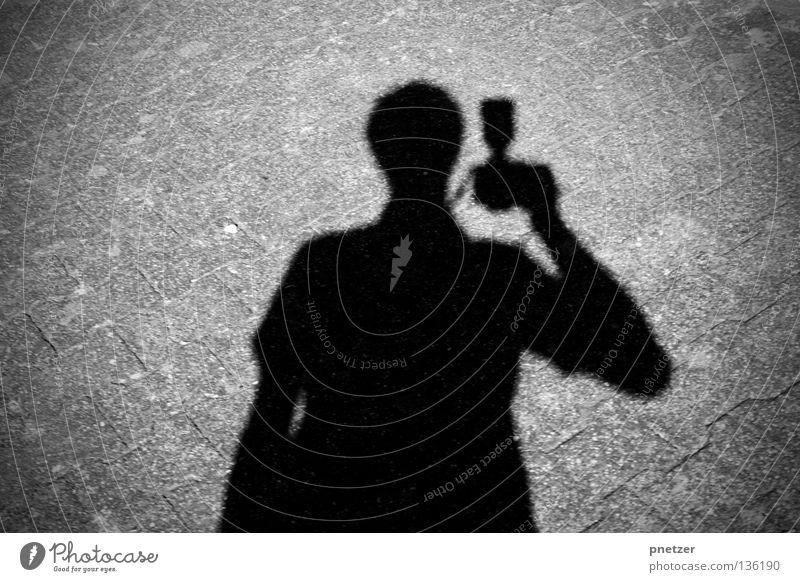 Shadowed Parazzo Black Gray Light Dark Asphalt Concrete Man Photography Photographer Paparazzo Pursue Sporting event Competition Street Lanes & trails