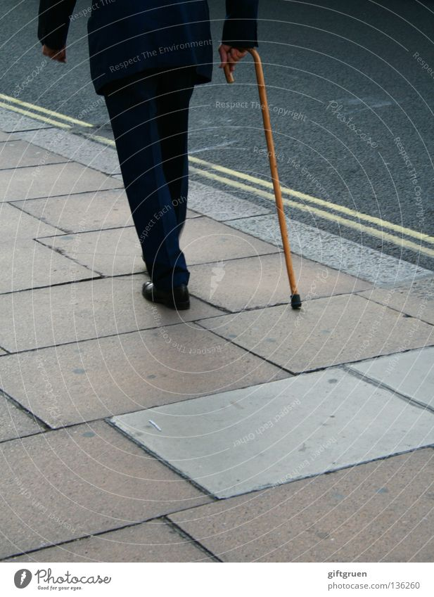 the long walk Man Stick To go for a walk Going Slowly Town Suit Senior citizen Traffic infrastructure Loneliness Street