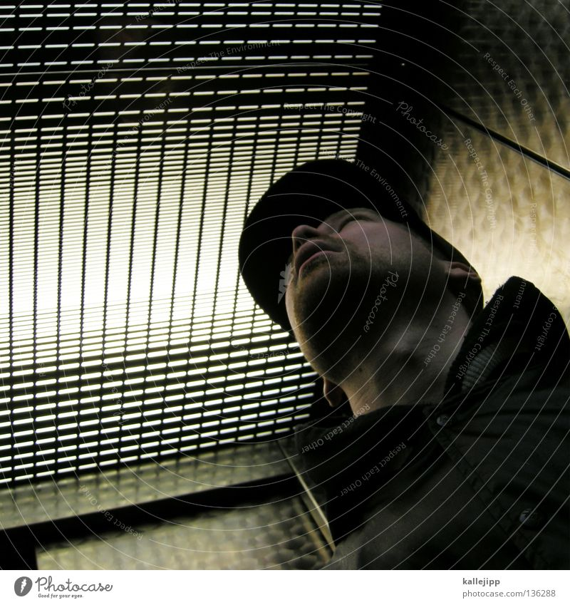 in the oven Man Baseball cap Cap Elevator Light Grid Manhunt Lifestyle Facial hair Worm's-eye view Jacket Tin Aluminium Safecracker Barbecue (apparatus)