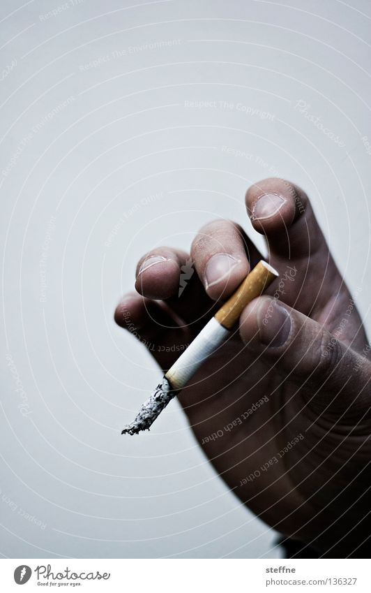 I'll get a cigarette. Cigarette Smoke Unhealthy Harmful Smoking Hand Fingers Man Odor Malodorous Men`s hand Filter-tipped cigarette Bright background
