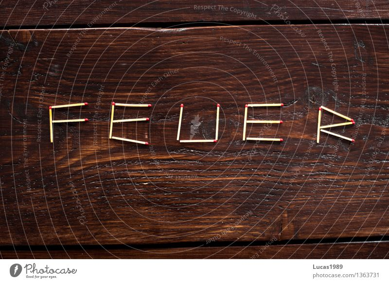 Fire - Super Still Life Match Blaze Wood Wooden table Wooden board Burn Arrangement Characters Dark Letters (alphabet) Kindle Colour photo Interior shot