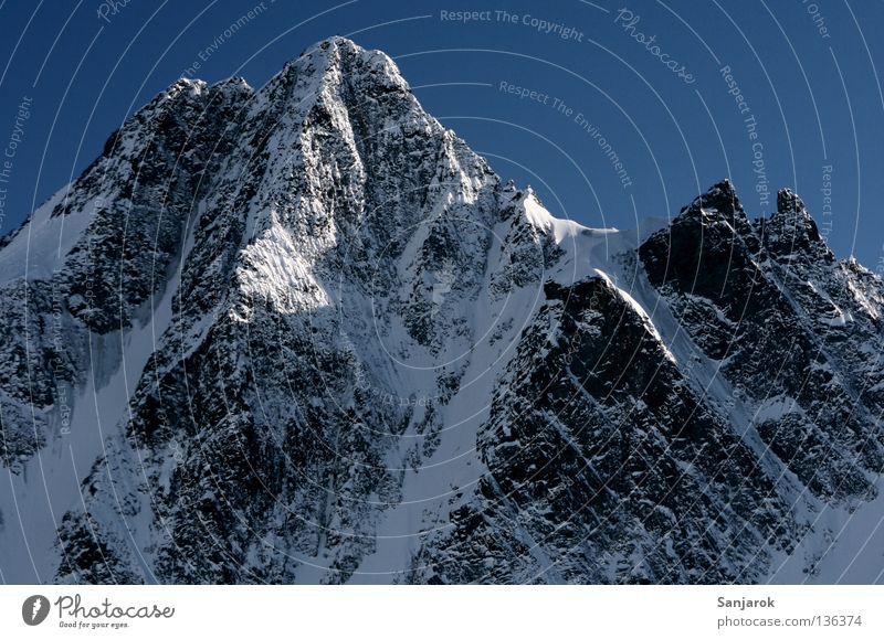 Winter Snow Mountain Rock Peak Austria Blue sky Steep Grossglockner High mountain region Steep face Snowcapped peak