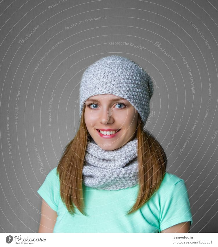 Smiling young girl in winter cap and scarf Joy Happy Beautiful Skin Face Cosmetics Winter Human being Girl Woman Adults Warmth Fashion Clothing Sweater Scarf