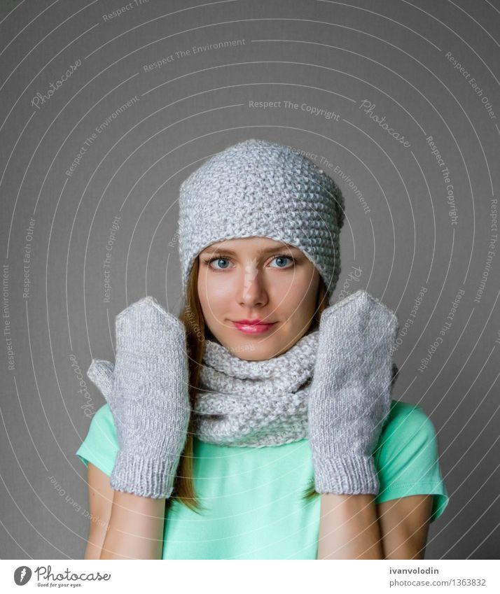 Smiling young girl in winter cap, scarf and mittens Human being Woman Youth (Young adults) Green Beautiful Young woman White Hand Joy Winter 18 - 30 years Face Adults Feminine Happy Head