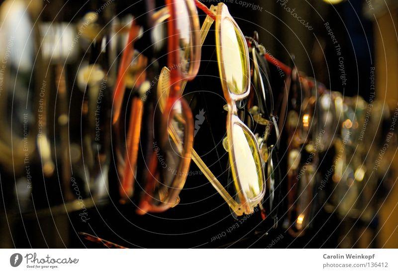 Insight. Eyeglasses Sunglasses Reading glasses Clothesline Blur Depth of field Red Yellow Flea market Junk Art Culture