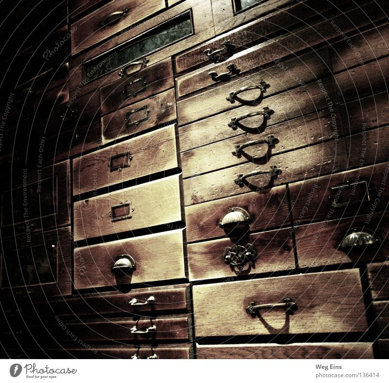 pigeonhole thinking Drawer Library Calm Dark Interior shot Quality Pharmacy Cupboard Shelves Wisdom Mysterious intellectual Baroque Old handles Contrast