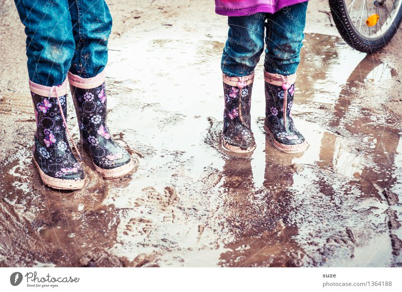Human being Child Joy Cold Autumn Playing Small Legs Fashion Feet Rain Weather Leisure and hobbies Dirty Earth Authentic