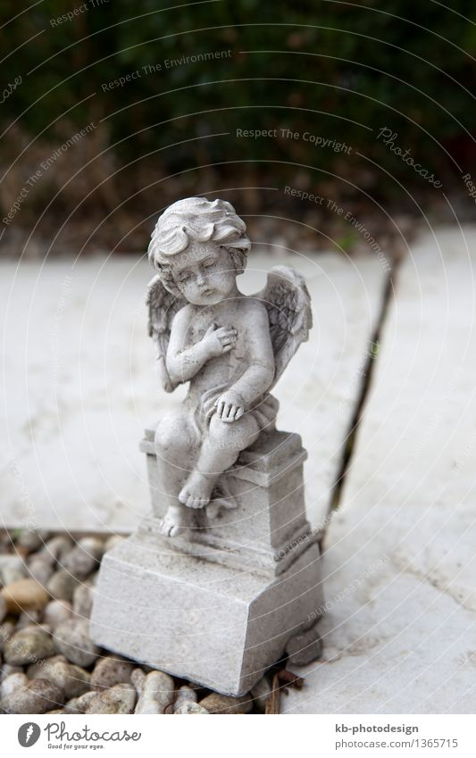 Stone angel with wings at the grave Christmas & Advent All Saints' Day Cry Peace Religion and faith Sadness farewell condolences funeral Bury tomb bible believe