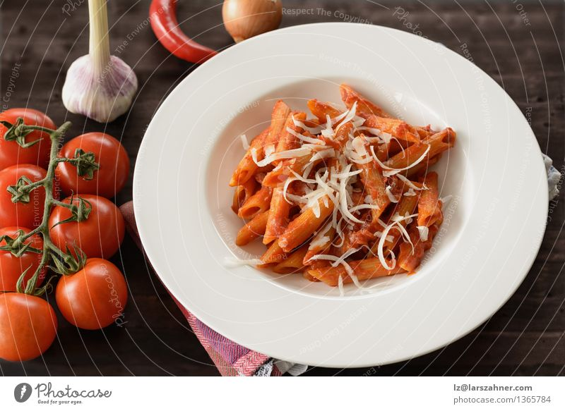 Plate of penne pasta with arrabiata sauce Cheese Herbs and spices Nutrition Lunch Fork Table Kitchen Restaurant Leaf Hot Delicious Tradition Food all'arrabiata