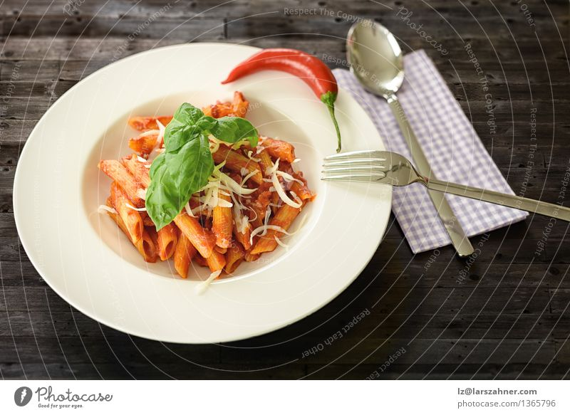 Plate of penne pasta with arrabiata sauce Cheese Herbs and spices Nutrition Lunch Fork Spoon Table Kitchen Restaurant Leaf Hot Delicious Tradition Food