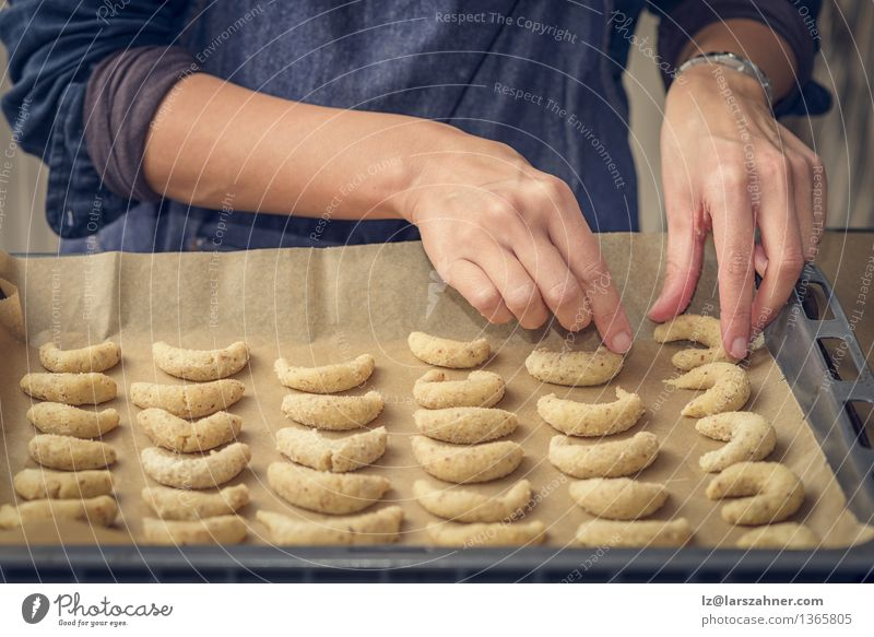 Cook preparing crescent biscuits for Christmas Dessert Nutrition Woman Adults Hand Stove & Oven Fresh Gold arrange arranging Bakery Confectionary Cookie fat