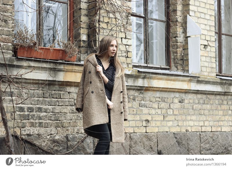 beautiful woman in coat looking away on the background of houses Human being Youth (Young adults) City Beautiful Young woman House (Residential Structure)