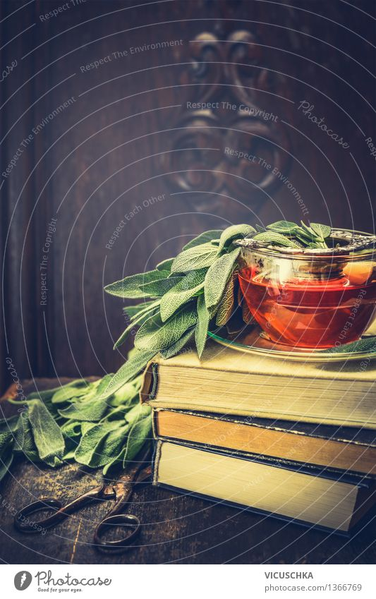 Herbs sage tea on pile of books and old scissors Organic produce Vegetarian diet Diet Beverage Hot drink Tea Cup Lifestyle Style Design Healthy