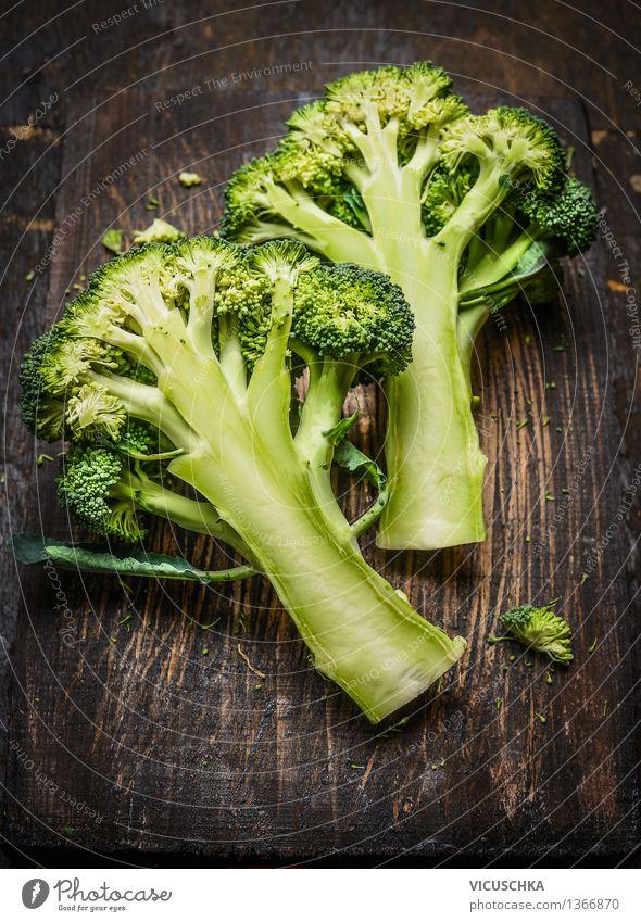 Broccoli on dark rustic wood Food Vegetable Nutrition Organic produce Vegetarian diet Diet Healthy Eating Life Table Design Style Vegan diet Dark Wooden table
