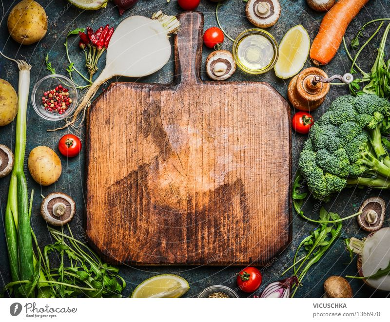 Fresh vegetables and ingredients for cooking around chopping board Food Vegetable Lettuce Salad Herbs and spices Cooking oil Nutrition Lunch Dinner