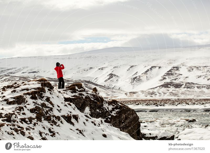 Hiker at mountain top of waterfall Godafoss in Iceland Tourism Adventure Far-off places Winter Mountain Hiking Waterfall Jump volcano island landscape volcanoes