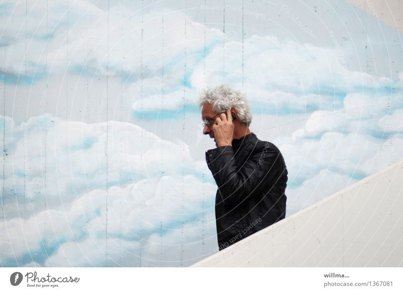 Man on the phone on stairs in front of painted cloud wall make a phone call Telecommunications smartphone mobile To talk Telephone PDA Stairs White-haired
