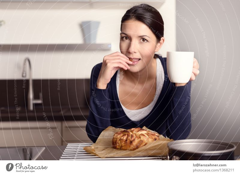 Young woman tasting her freshly baked cake Fruit Apple Dessert Eating Coffee Lifestyle Happy Face Kitchen Cook Woman Adults 1 Human being 30 - 45 years Brunette