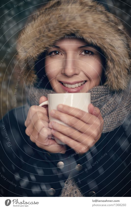Young woman holding warm cup of tea Human being Woman White Winter Face Adults Warmth Snow Happy Lifestyle Fashion Weather Beverage Friendliness Seasons Drinking