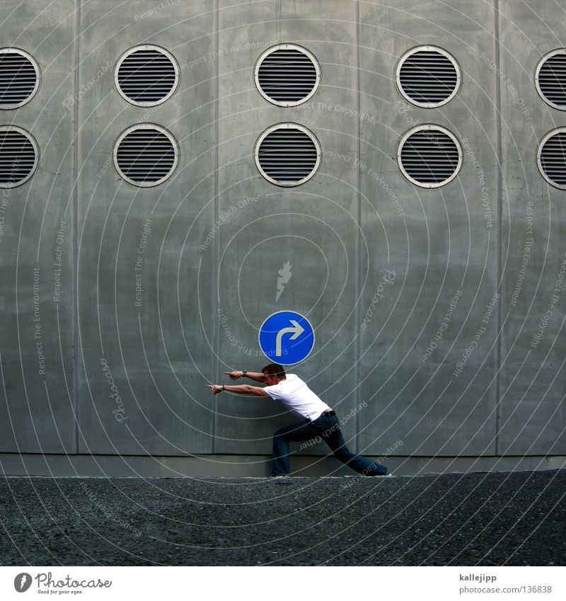 Human being Vacation & Travel Man Blue City Wall (building) Street Movement Gray Transport Lifestyle Signs and labeling Concrete Circle Round