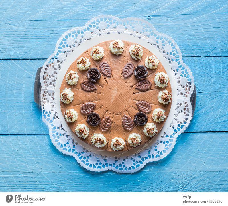 Chocolate cream cake on blue wood with cake lace Cake Dessert Wood Blue chocolate cream cake Gateau foam pastries Cream cake top Baked goods sponge cake