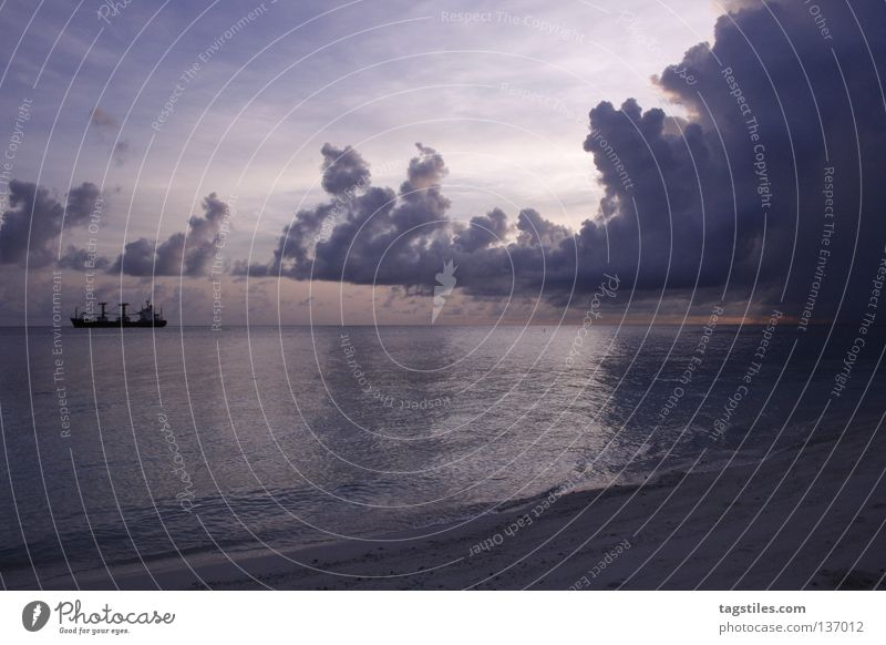 size matters Playing Coil Clouds Maldives Cargo-ship Watercraft David and Goliath Summer Sunrise Ocean India Asia Beach Vacation & Travel Tourism Violet